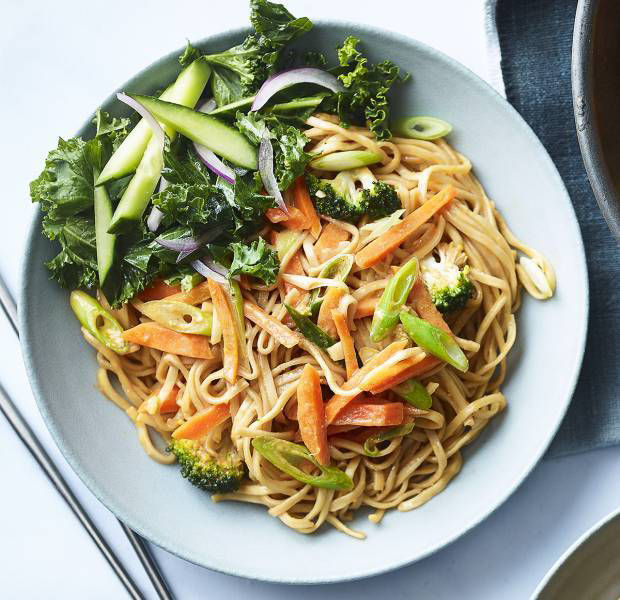 Spicy peanut noodles with cucumber and kale salad