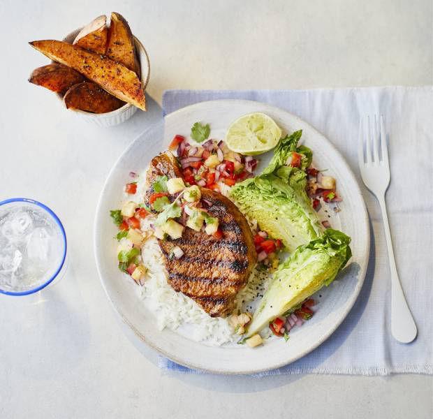 Hawaiian-style pork steaks with rainbow salsa and sweet potato 'fries'