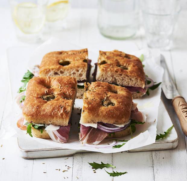 Focaccia with ham, olives, red onion and rocket