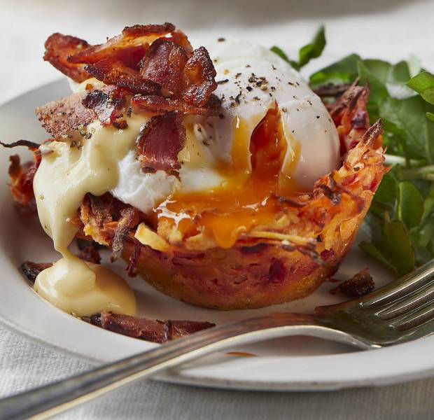 Root veg rösti nests with poached eggs, crispy bacon and creamy hollandaise