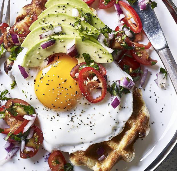 Golden-yolked huevos rancheros on waffles with avocado and a chilli salsa