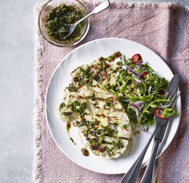 Cauliflower 'steaks' with chimichurri sauce and a rocket salad