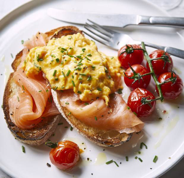Smoked salmon and scrambled eggs with a glass of fizz
